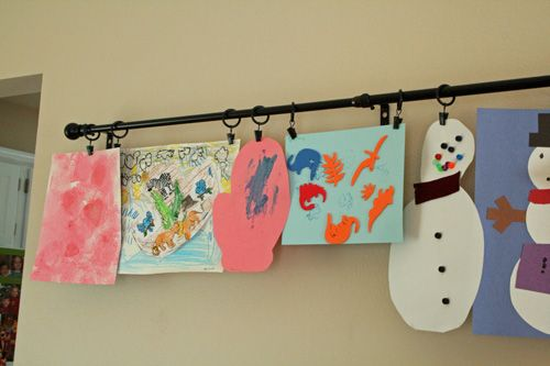 Display the kids' artwork with a curtain rod and the clippy thingies. Hmmmm....but WHERE??