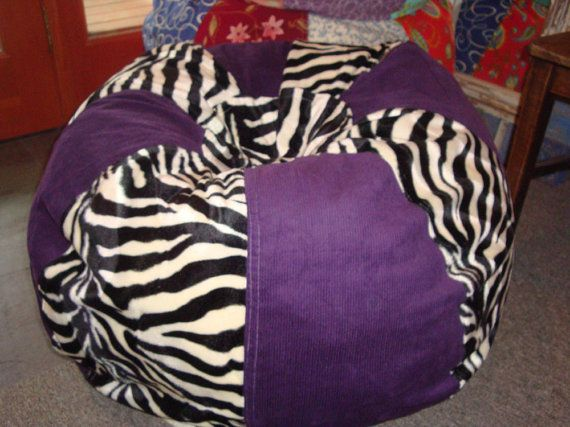 Black and white zebra with Solid Purple Bean bag chair by Paniolo