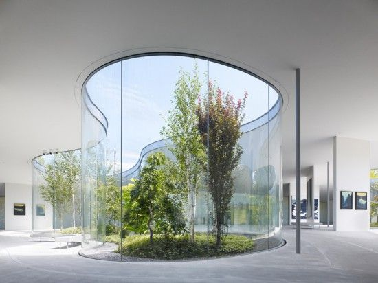 The building is by Ryue Nishizawa of SANAA, who does wonderful things with untreated concrete, curved glass and natural light.
