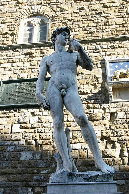 A replica of Michelangelo's  David standing in the original location of David, in front of the Palazzo Vecchio in Florence, Italy.  In 1873 the statue of David was removed from the piazza, to protect it from damage, and displayed in the Accademia Gallery, Florence, where it attracts many visitors. A replica was placed in the Piazza della Signoria in 1910.