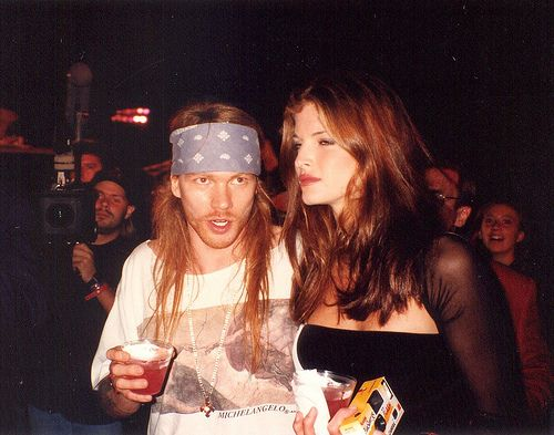 Axl Rose with ex girlfriend Stephanie Seymour, early '90s. One of my favorite singers and one of my favorite models. I love them.
