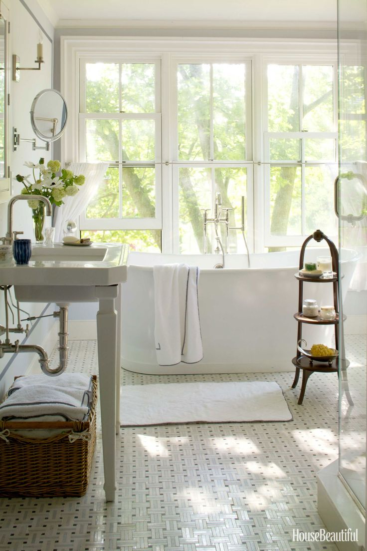 The Sunrise Specialty Piedmont tub and Kohler Kathryn sink in the master bath speak to the simplicity of the house. Floor tile, Countrytown Marble & Tile. - HouseBeautiful.com