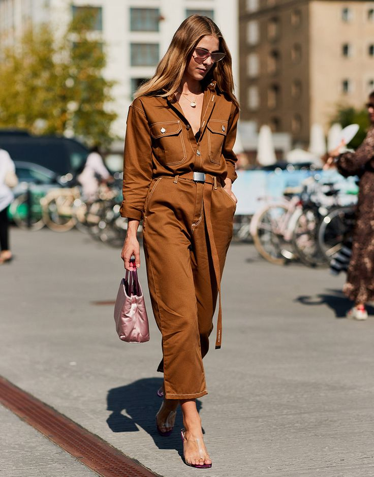 Great street style in copenhagen wearing a rust colored jumpsuit