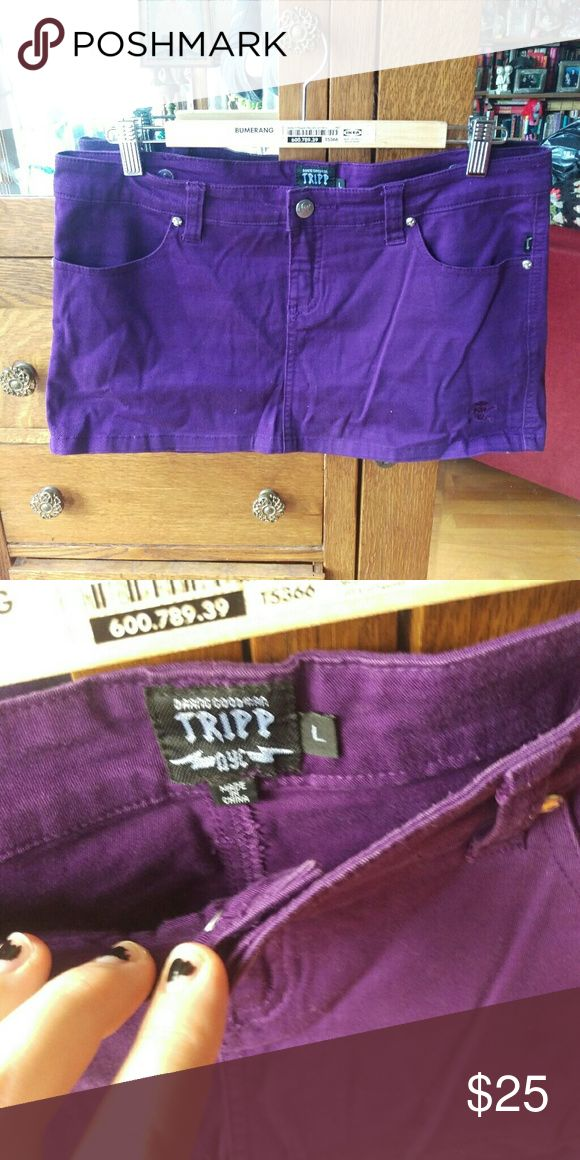 Purple Tripp mini skirt Purple denim mini skirt. Note that the color is much more violety than it appears in the first picture due to lighting (see second picture)  **10% off bundles! All offers considered** Emo punk goth rocker raver hot topic 2000s 00s gothic lolita kawaii pinup retro scene psychobilly rockabilly Tripp nyc Skirts Mini