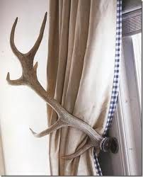 DIY antler curtain tiebacks! Perfect in a cabin or farm house.