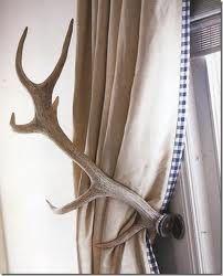 DIY antler curtain tiebacks! Perfect in a cabin or farm house.