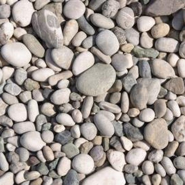 Smooth, rounded river rocks offer a comfortable walking surface on bare feet.