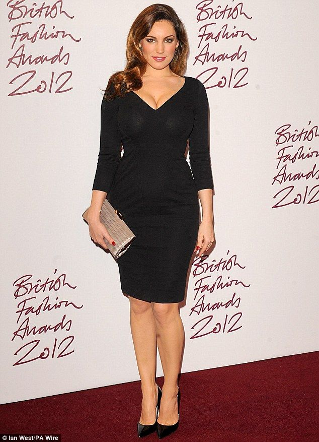 Stylish: The 33-year-old model joked that her choice of outfit was reflective of the miserable British weather of late