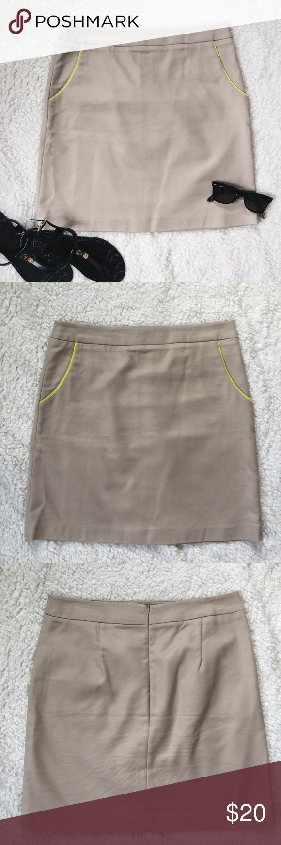 Cynthia Rowley Khaki Skirt Khaki pencil skirt. Pockets with neon yellow piping accents. Back zipper closure. Length is above the knee.  Condition: Gently worn.   ◆If you'd like more pics or have questions, ask! 🚫NO TRADES🚫 Cynthia Rowley Skirts