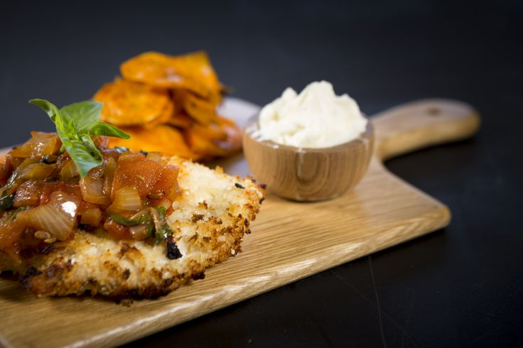 Low Fat Crumbed Chicken served with Sweet Potato Chips, Tomato Salsa, Ricotta, finished with Fresh Basil