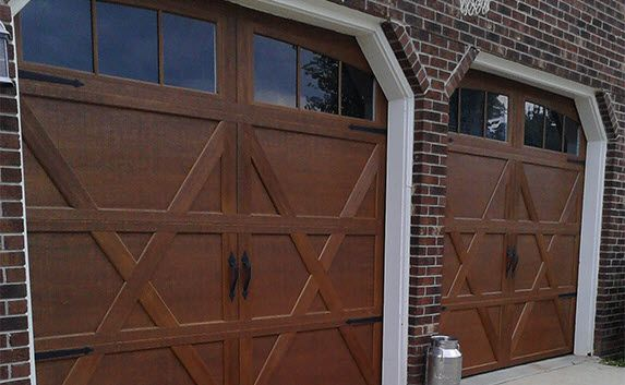Wood look doors with windows and black straps by Wayne Dalton. Garage Door Photo Gallery - Residential