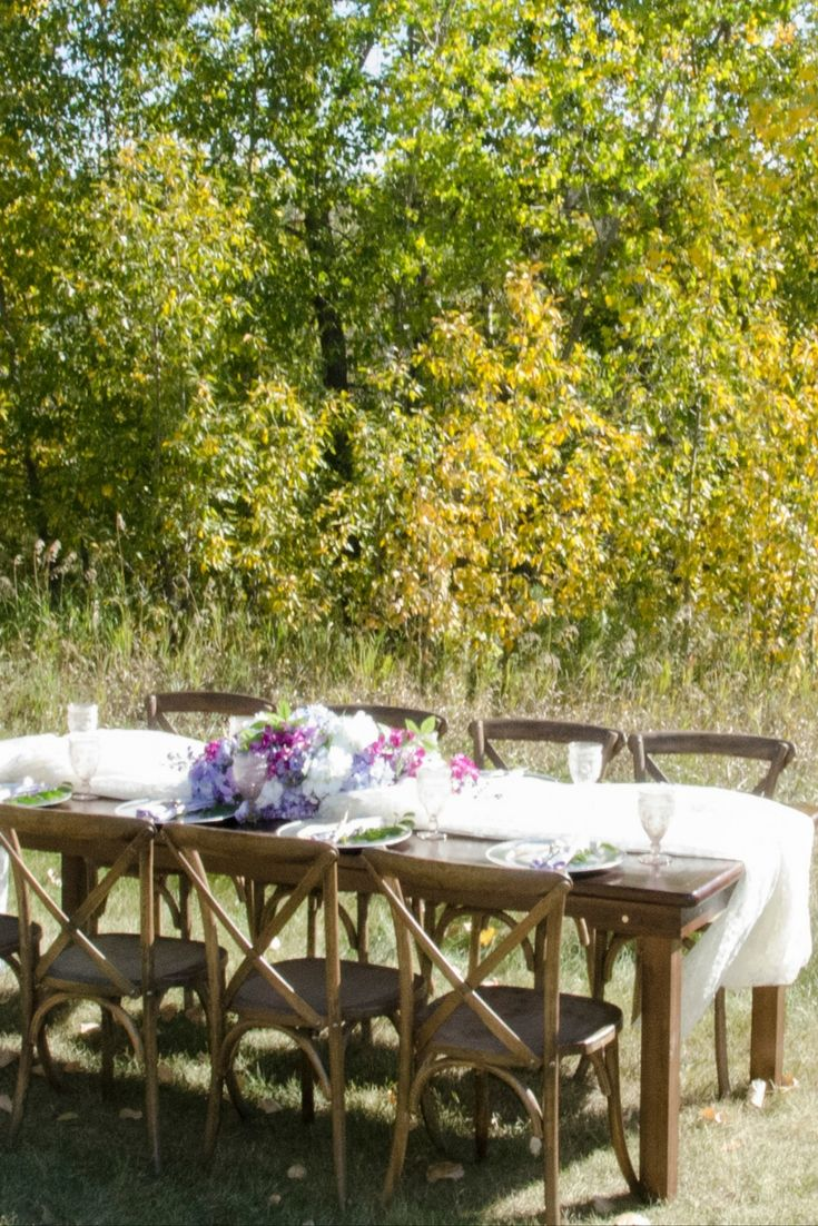 Farm tables and rustic cross back chairs are perfect for your outdoor event