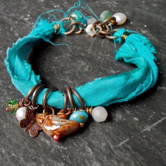 Turquoise Sari Silk and Ceramic Bird Bracelet by songbead on Etsy, £15.00