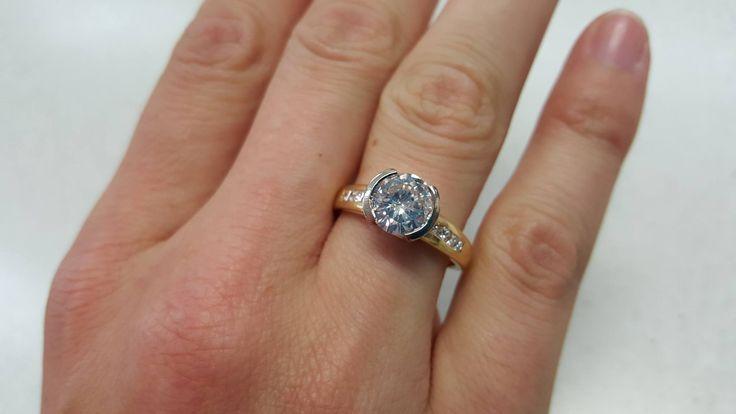 1.61ct brilliant cut diamond in centre.  18ct yellow & white gold