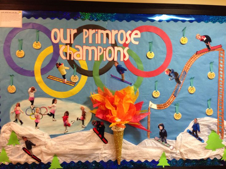 Olympic Preschool Bulletin Board 2014. I drew a ski jump and ice rink, then had the children pose. The skis, ice skates, and snowboards were drawn onto photo paper, then cut out and attached to the cutout pictures of the children. The medals were made with air dry clay and decorated with glitter.