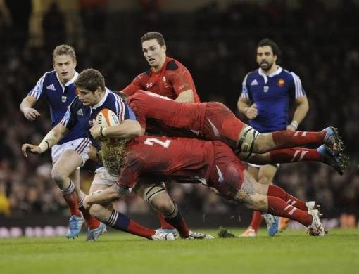 Wales' Richard Hibbard (lower R) and Taulupe Faletau tackle France's Pascal Pape during the Six Nations Championship rugby union match at th...