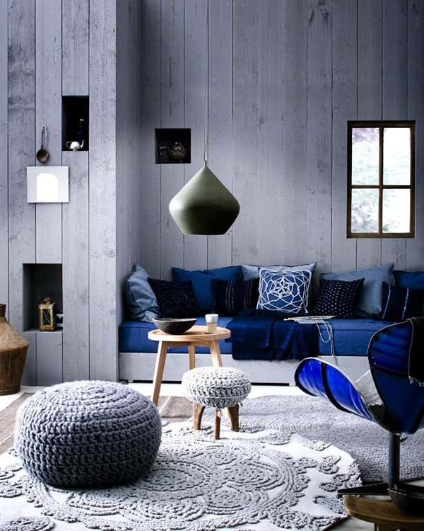 Grey wood paneled walls and a green Beat light from Tom Dixon