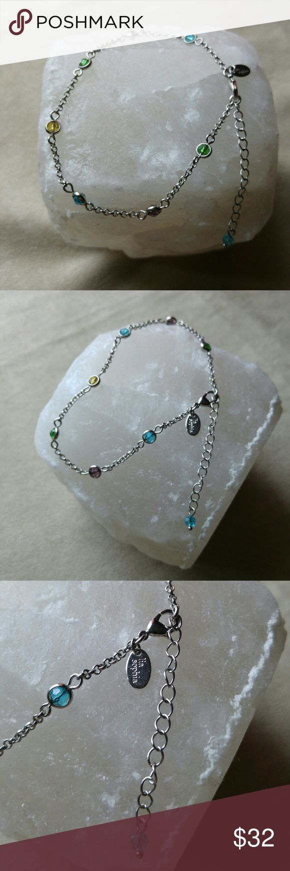 Lia Sophia Sweet Tart Ankle Bracelet Anklet Colorful Lia Sophia Ankle Bracelet features yellow, green, blue and purle pastel colored glass beads on a silver tone chain. Lobster clasp.  Adjustable 9.5 to 11.5 inches.   Excellent condition! Lia Sophia Jewelry