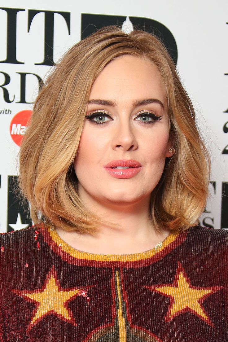 Adele stood out on the red carpet at this year's Brit Awards with her new cut, worn with a natural wave and slightly off centre. Getty Images   - HarpersBAZAAR.co.uk