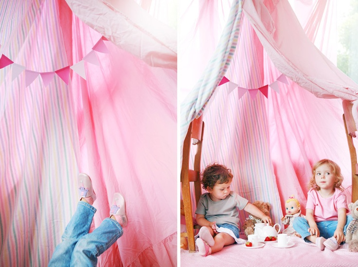 awesome picture, but i love the sheet tent/fort. we could all use more pink sheet tents in our homes.