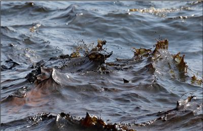 Gerald Herbert shot whitecaps sloshing against the side of a ship near the site of the Deepwater Horizon oil spill for AP. As we all learned long ago, oil and water don't mix.