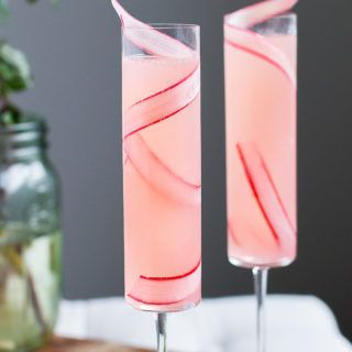 This Rhubarb 75, a simple, seasonal twist on the classic French 75, will quickly become your favorite (and most elegant) way to day drink.