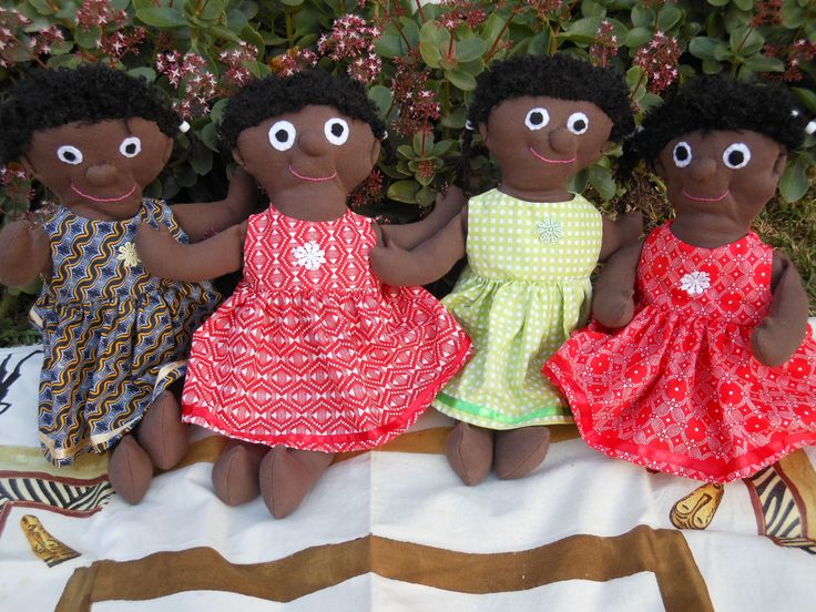 These black babies with their pretty African print dresses were made for an Aids orphanage in South Africa.  Their bodies were made from a cotton knit and this made them so soft and cuddly.  Their hair was made from a wooly polar fleece.