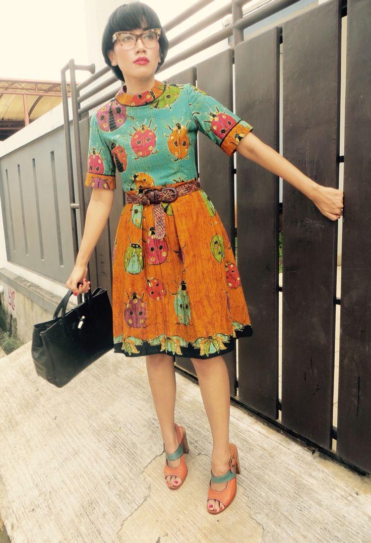 wearing Batik Amarillis's It Girl dress in hand drawn Batik wonogiren (ladybug series) of Indonesia , Miu Miu glasses and Longchamp croco bag.