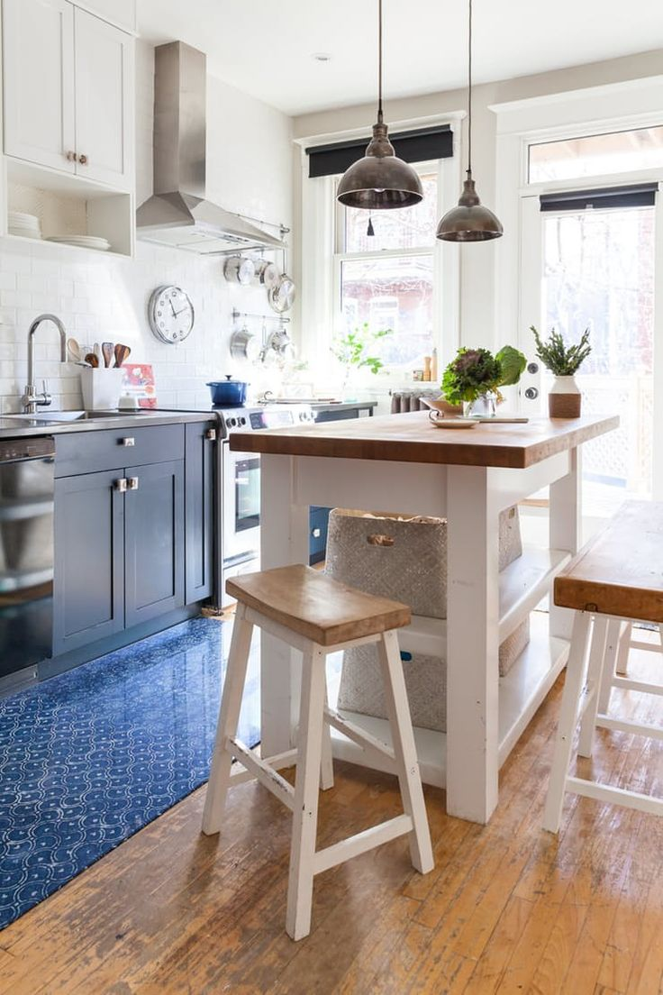 """""""The island gives additional counter space and is a casual spot for the family to share a meal."""" While the high bench provides ample seating, """"having the family room right off the kitchen now allows everyone to hang out close to one another during meal preparation—without having too many cooks in the kitchen.""""  See more Kitchen Island Breakfast Bar Ideas & Inspiration 