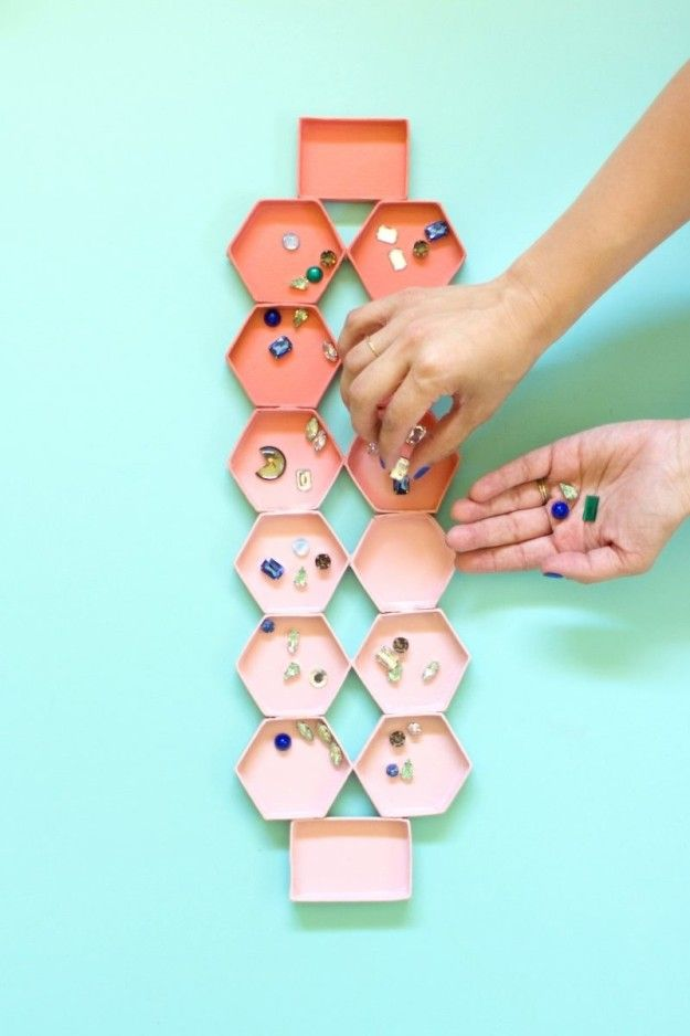 Create your own Mancala set by gluing together a bunch of leftover lids from jewelry gift boxes.