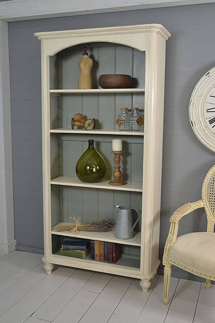 #letstrove This simple yet striking slimline bookcase can fit just about anywhere! Painted in Farrow & Ball Lime White with Pigeon inside, for a rustic farmhouse feel. https://www.thetreasuretrove.co.uk/cabinets-and-storage/tall-slimline-shabby-chic-vintage-pine-bookcase #farmhousefurniture #shabbychic #rustic #farrowandballlimewhite