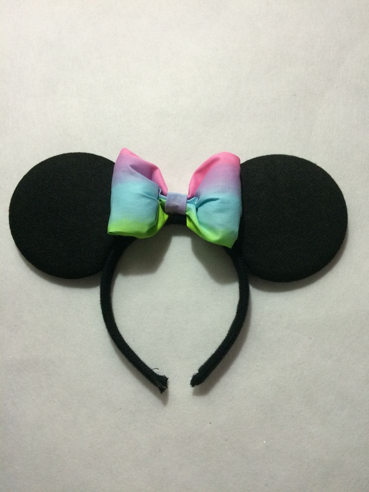 Minnie Mouse inspired ears with a rainbow bow :) (any colour bow available to match your outfit)