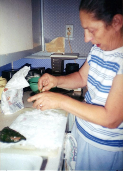 The reason I do what I do!!! Mom stuffing the chiles rellenos!!