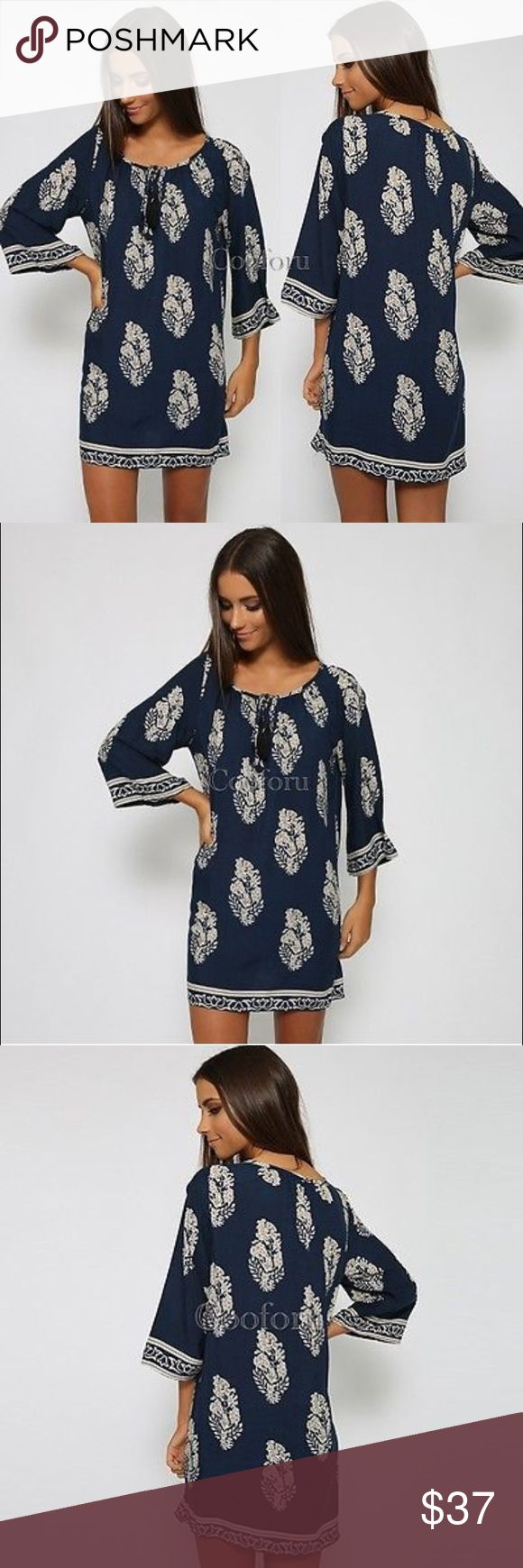 "⚜""Coco"" ll Bohemian Summer Mini Dress ⚜ This navy bohemian dress is sure to flatter this summer. Light weight fabric is perfect for a hot day. Neck has two small strings for added detail. Up close photo shows floral pattern best. Low stock! 💕 Dresses Mini"
