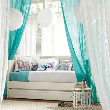 Turquoise And White Couch Behind Turquoise Curtains Via For The Home