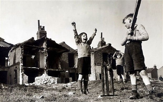 When cricket was cricket.  The Second World War briefly put professional cricket on hold, but children still played the sport, even amongst the rubble of bombed London.  This photograph shows John Hudd, a seven-year-old from Canning Town, playing cricket with his brothers during the Blitz