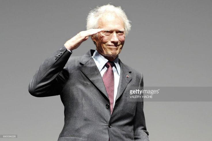 US director Clint Eastwood acknowledges applause on stage during the presentation of the 4K remaster of his 1992 film 'Unforgiven' on May 20, 2017 during the 70th edition of the Cannes Film Festival in Cannes. / AFP PHOTO / Valery HACHE