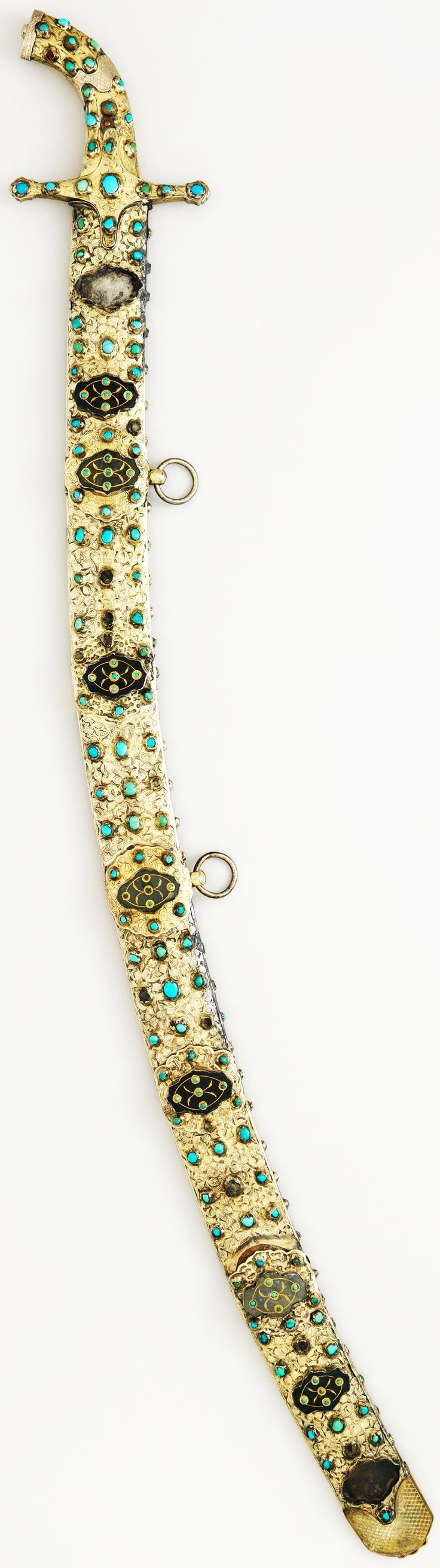 Ottoman karabala style scimitar, early 17th c, steel, brass, silver, gold, jade, turquoise, L., 42 1/16 in. (106.83 cm); sword L., 40 1/8 in. (101.9 cm); blade L., 35 in. (88.9 cm); Wt., 4 lb. 4 oz. (1928 g), Met Museum. This is a typical Ottoman presentation saber of the 17th c. Many similar weapons, as well as shields and complete horse trappings similiarly mounted in silver-gilt and set with jade plaques and turquoise, were captured after the unsuccessful Turkish seige of Vienna in 1683.