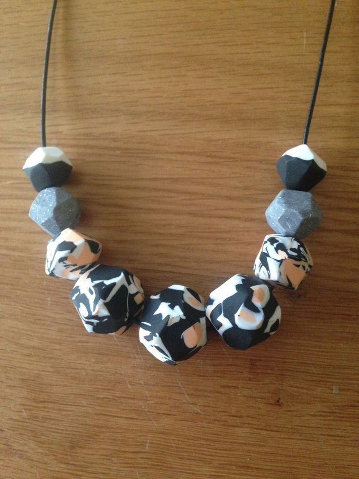 Polymer clay necklace, geo cut black/white/peach by AllsKnotForgotten on Etsy https://www.etsy.com/listing/190202432/polymer-clay-necklace-geo-cut