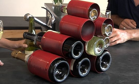 Tin Can Wine Rack - Remove both ends of the can, arrange, stack, and glue. Paint the cans beforehand if you want to add some color.