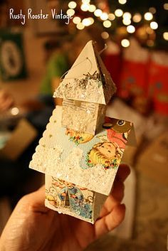 handmade house or church with old christmas cards and glitter.