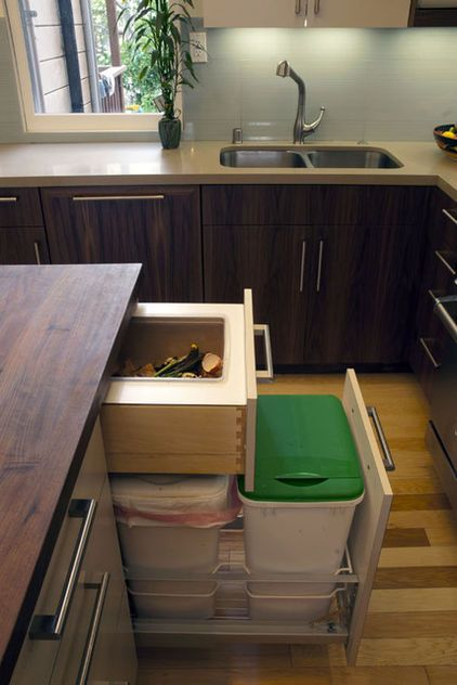 Make going green a habit by placing the recycling bin next to the trash can. This terrific recycling hub has a built-in compost drawer paired with a pullout trash can and a general recycling drawer. It makes for easy cleanup without taking up valuable floor space.