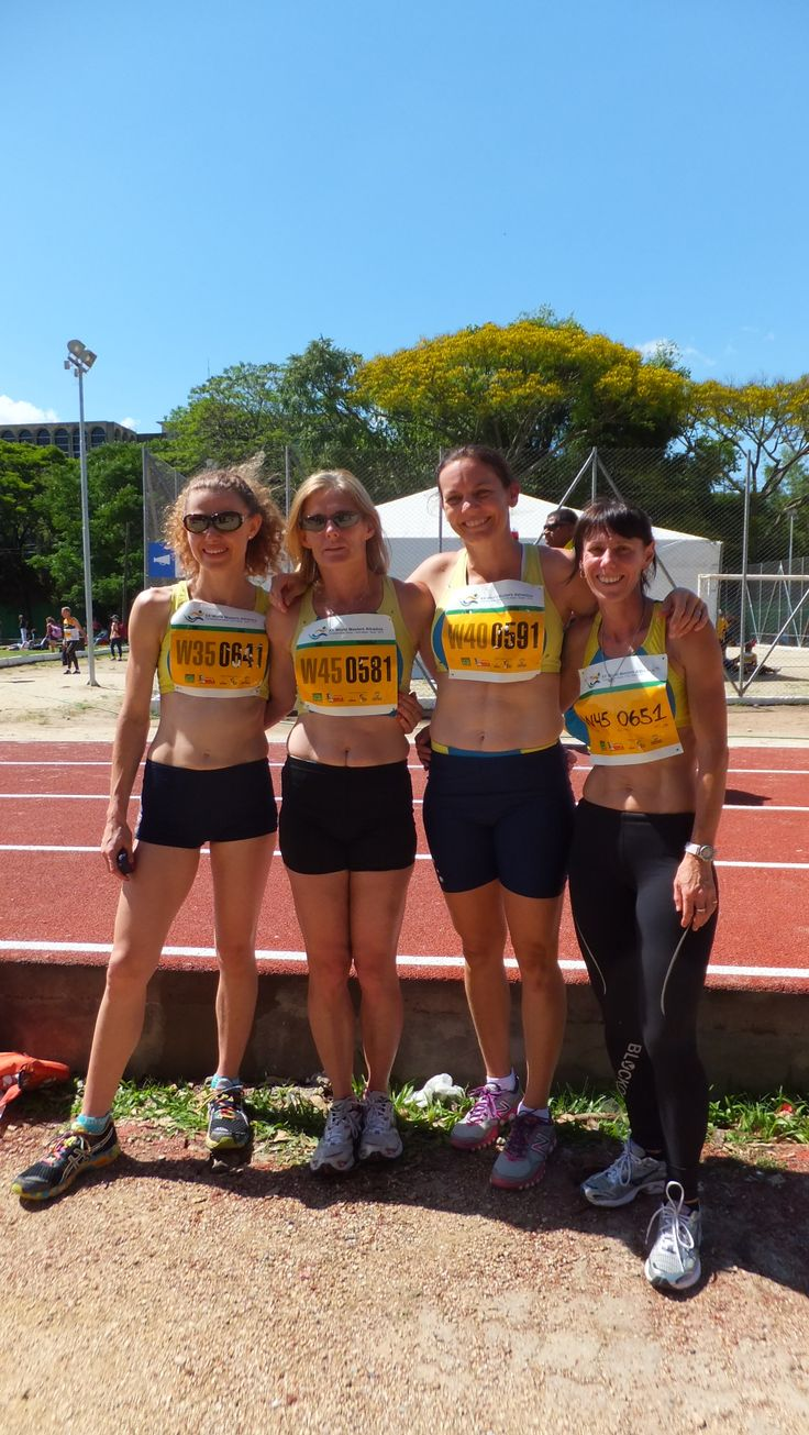 Bronze in the 4 x 400m relay standing in running order from left to right.
