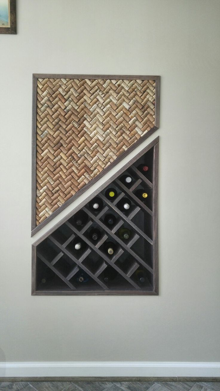 This is the fruit/result of viewing, pinning, revising, and collecting many pictures for my wine cellar board. This is built in wine rack. We used space that we have under the stairs. This is why it has this shape. To add some consistency we added wine cork board that is also built-in. It located in one of the walls of my kitchen and I just love that is nothing poking out and takes additional space. Made out of red oak with two layers of .