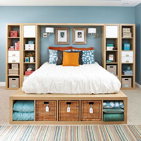 Off-the-shelf storage units turn into a one-of-a-kind storage unit in this comfortable, pretty master bedroom. The homeowners took advantage of height -- grouping two tall units together -- as well as closed and open units thanks to doors and boxes. A platform bed offers storage, too, for extra blankets and more.