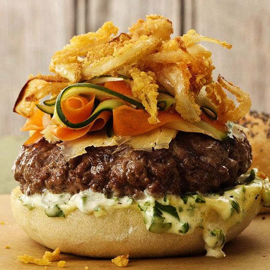 Smoky Cedar-Planked Burger by Better Homes and Gardens. Layers of cilantro-jalapeno sauce, Gouda cheese, pickle ribbons, and tortilla-crusted onion rings take this simple cedar-planked burger to a whole new level. One bite, and you just might think you're in burger heaven.