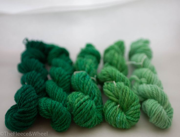 Handspun yarn from Australian Castledale roving dyed in a gradient of greens.