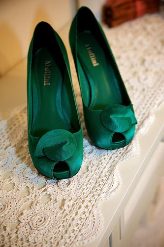 Shoes  These emerald heels are the perfect pop of color under a bride's white dress.