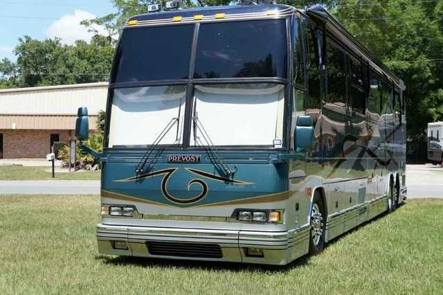 2002 Used Prevost Featherlite H3 45 Class A in Florida FL.Recreational Vehicle, rv, One Owner, Garage Kept, Several Recent Upgrades, Heated Granite and Wood Floors, Separated His & Her Vanities, Mileage: 136k, Series 60 Detroit 500hp (12.7L), Allison 6 Speed Transmission, Trans Retarder Brake (6-Position), Michelin Tires (Upgraded 365 Steering-Tag), (4) Chassis Batteries-Group 31, (8) House Batteries-4D, Double Girard Awnings (Curb Side), Upgraded Girard Slide Window Awnings, Meticulous…