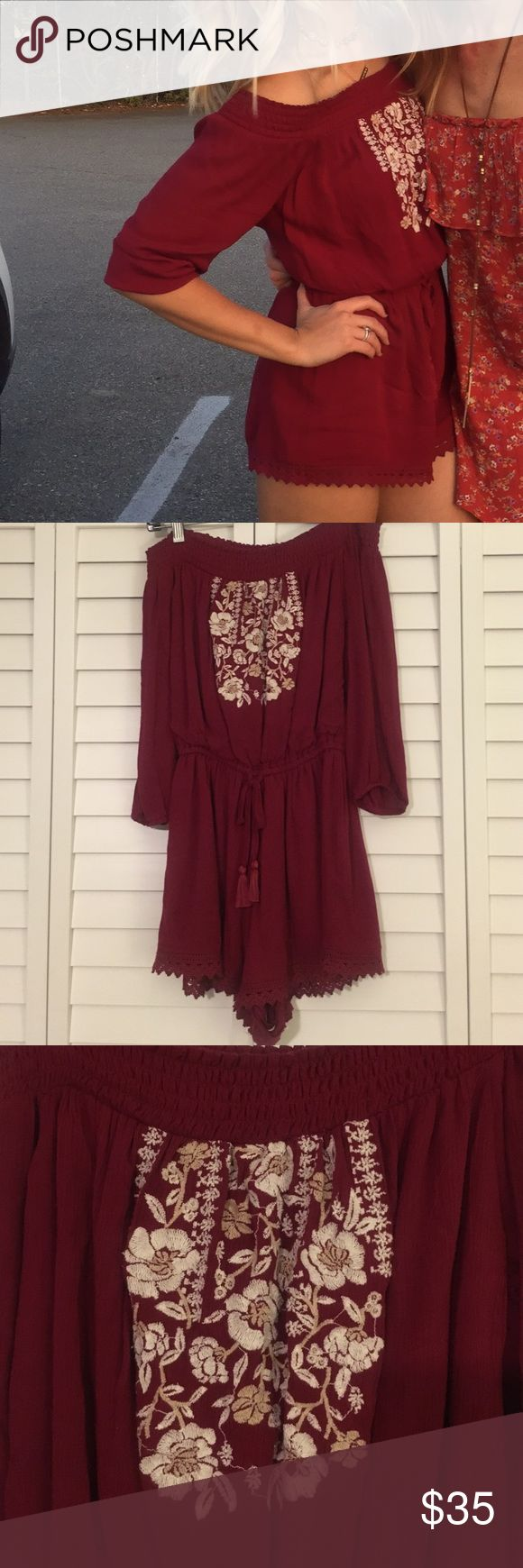 Red romper from A&F Adorable off the shoulder red romper from A&F! Only worn 3 times! Paired once with cowgirl boots for a country concert, also worn with sandals at a baseball game! Abercrombie & Fitch Dresses